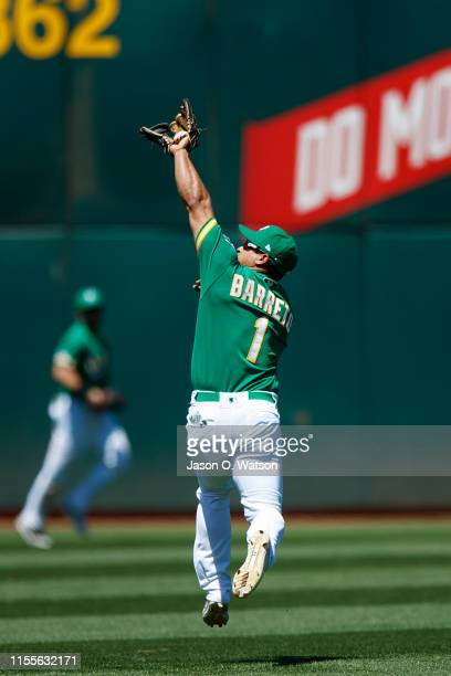 Franklin Barreto of the Oakland Athletics catches a line drive hit off the bat of Jose Rondon of the Chicago White Sox during the fifth inning at the...