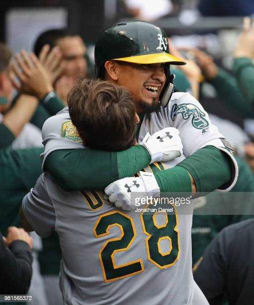 Franklin Barreto of the Oakland Athletics is lifted by teammate Matt Olson after hitting his second three run home run of the game in the 8th inning...
