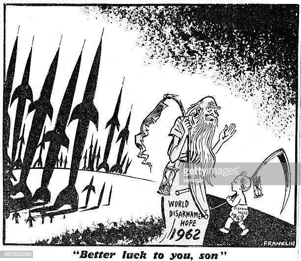 Franklin cartoon 1st January 1963 Father Time in a robe bearing the words World Disarmamnet hope 1962 carrying a battered scythe walks pass a baby...