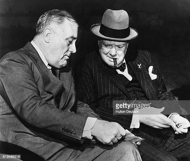 Franklin D Roosevelt and Sir Winston Churchill discuss details of Germany's surrender in one of their last meetings at Casablanca Both leaders agreed...