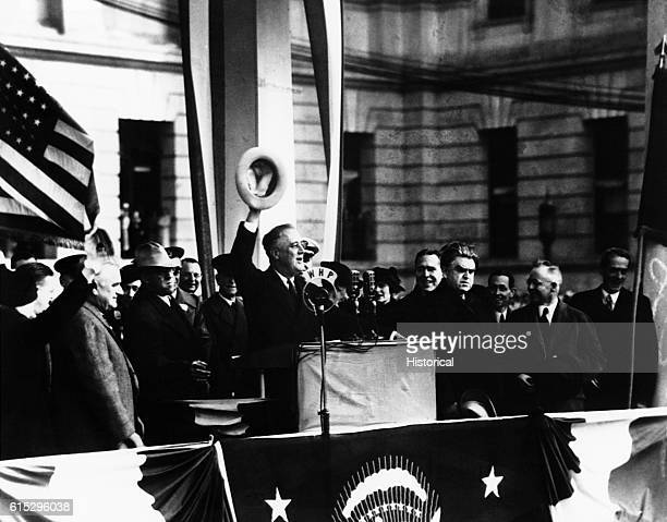 Franklin D. Roosevelt campaigning with labor leader John L. Lewis , and Marvin McIntyre in Wilkes-Barre, Pennsylvania.
