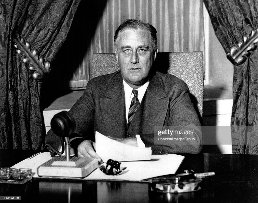 Franklin Delano Roosevelt (1882-1945), 32nd President of the United States of America 1933-1945, giving one of his 'fireside' broadcasts to the American nation during. : News Photo
