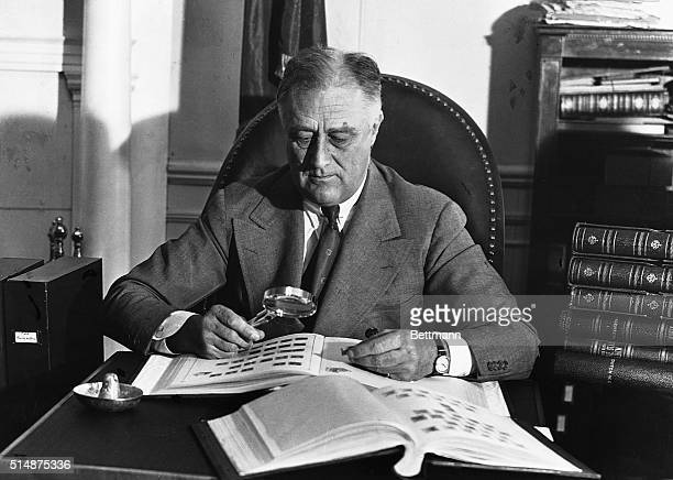 Franklin Delano Roosevelt looks at his stamp collection to distract his attention from the immense pressure which has just erupted as a result of the...