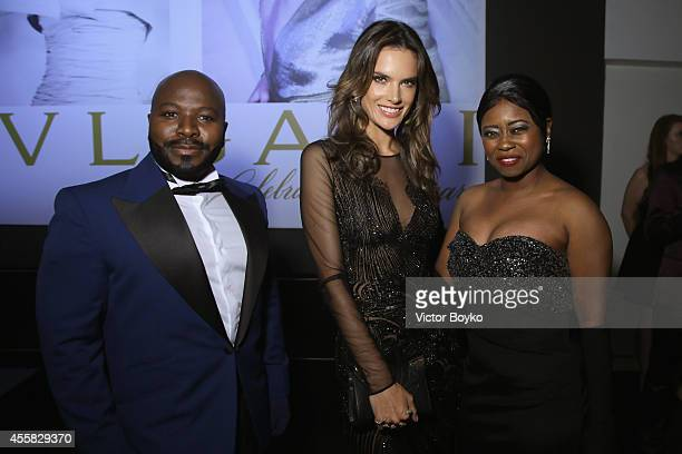 Franklin Eugene, Taylor Re' Lynn and Alessandra Ambrosio attends the amfAR Milano 2014 - Cocktail as part of Milan Fashion Week Womenswear...