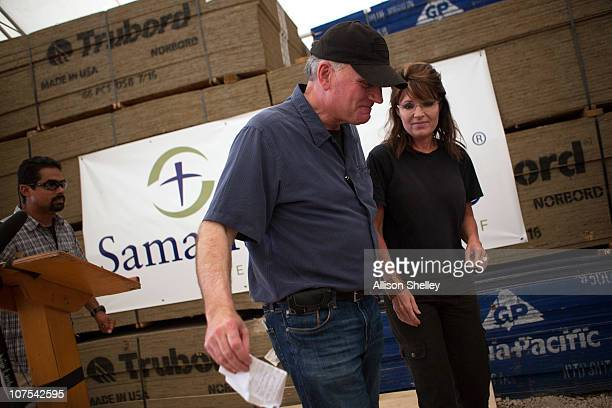 Franklin Graham and Sarah Palin leave the podium after holding a press conference in a supply warehouse on the grounds of the Samaritan's Purse...