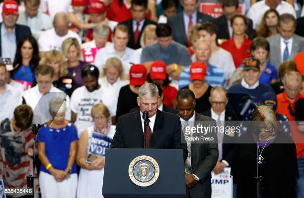 Franklin Graham son of evengelist Billy Graham leads a crowd in prayer at the Phoenix Convention Center during a rally for US President Donald Trump...