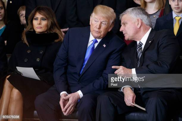 Franklin Graham talks with President Donald Trump during a ceremony as the late evangelist Billy Graham lies in repose at the US Capitol on February...