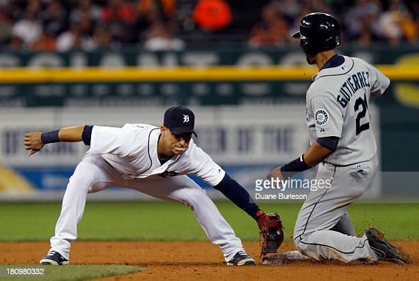Franklin Gutierrez of the Seattle Mariners beats the tag from shortstop Jose Iglesias of the Detroit Tigers to steal second base in the third inning...