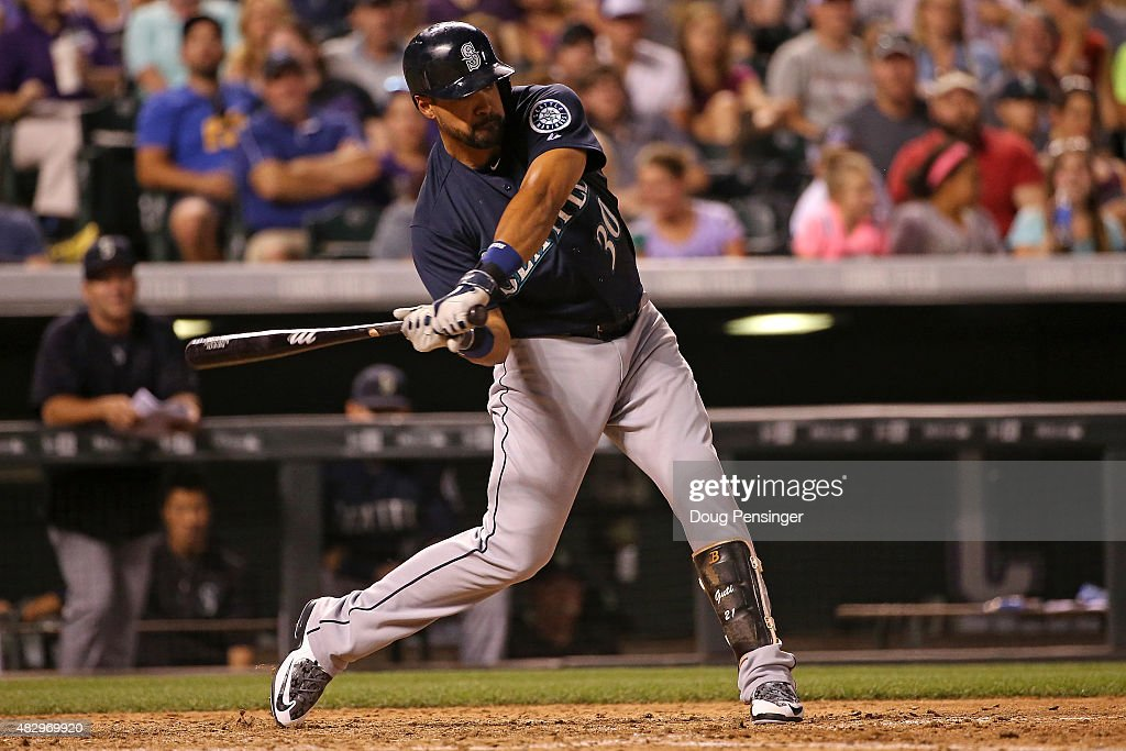 Franklin Gutierrez #30 of the Seattle Mariners hits a two RBI pinch hit single off of Christian Friedrich #53 of the Colorado Rockies to take a 5-3 lead in the sixth inning during interleague play at Coors Field on August 4, 2015 in Denver, Colorado.