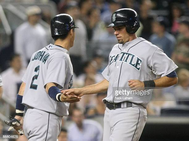 Franklin Gutierrez scores a run and celebrates with teammate Kenji Johjima of the Seattle Mariners of the New York Yankees at Yankee Stadium on July...