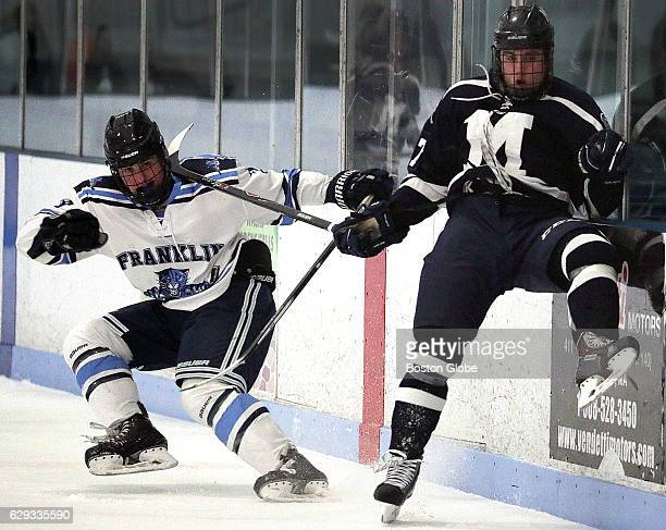 Franklin High School's Matt Crane check's Medfield High School's Jim Freeman during a scrimmage in Franklin Mass on Dec 7 2016