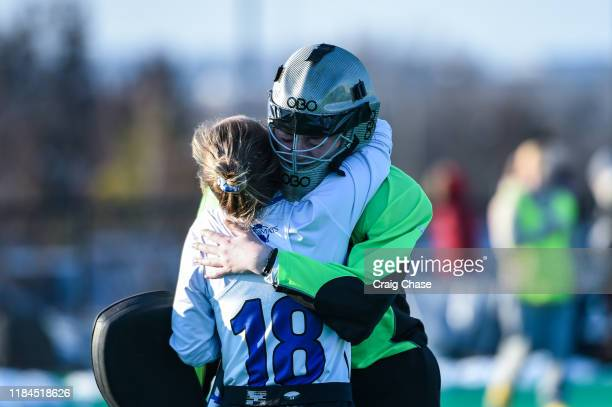 Franklin Marshall Diplomats Goalie Christina Seery hugs Addie Peters after losing to the Middlebury Panthers at the Division III Women's Field Hockey...
