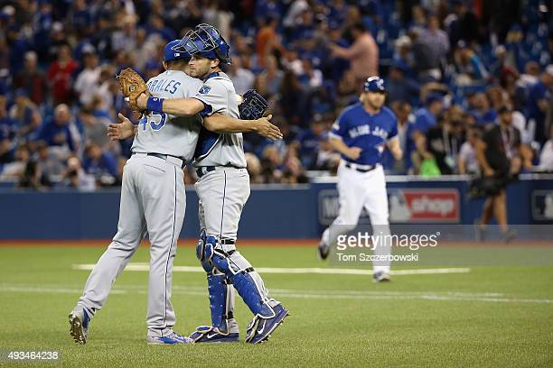 Franklin Morales of the Kansas City Royals and Drew Butera of the Kansas City Royals celebrate defeating the Toronto Blue Jays 142 in game four of...