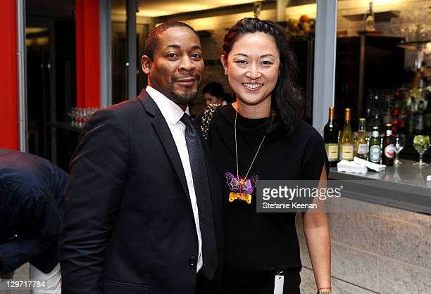 Franklin Sirmans and Christine Y Kim attend at LACMA on October 19 2011 in Los Angeles California