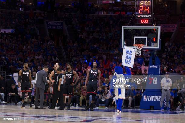 Franklin the Dog of the Philadelphia 76ers holds up a sign in front of Wayne Ellington Kelly Olynyk Justise Winslow and Bam Adebayo of the Miami Heat...
