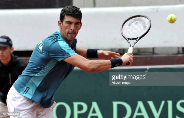 Franko Skugor of Croatia plays a backhand during a match against Santiago Giraldo of Colombia as part of Davis Cup at La Santamaria Ring Bull on...