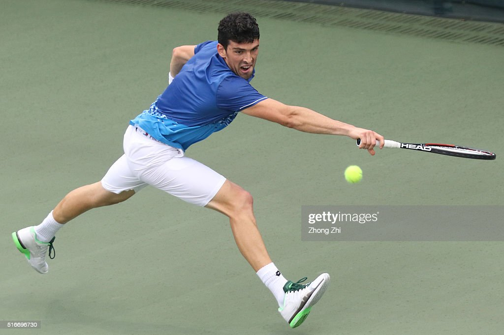Franko Skugor of Croatia returns a shot during the match against Nikoloz Basilshvili of Georgia during the 2016 'GDD CUP' International ATP Challenger Guangzhou Tour Day 6 match at Guangzhou Development District International Tennis School on March 20, 2016 in Guangzhou, China.