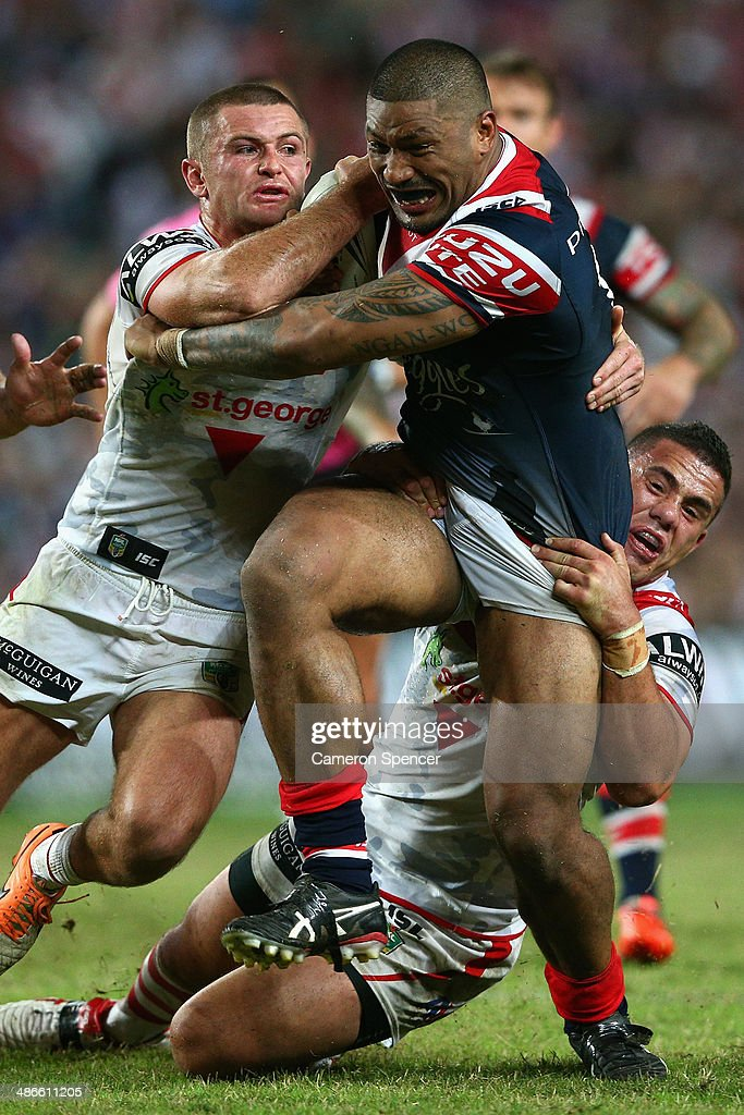 Frank-Paul Nu'uauasala of the Roosters is tackled during the round 8 NRL match between the St George Illawarra Dragons and the Sydney Roosters at Allianz Stadium on April 25, 2014 in Sydney, Australia.