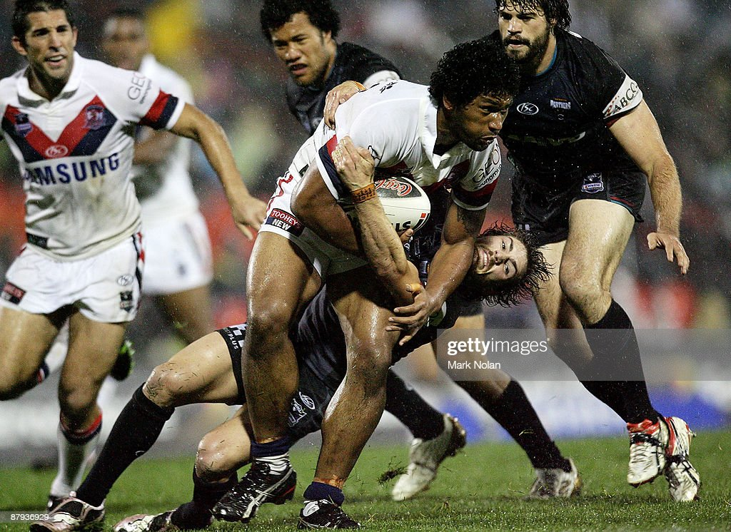 Frank-Paul Nuuausala of the Roosters is tackled by Jarrod Sammut of the Panthers during the round 11 NRL match between the Penrith Panthers and the Sydney Roosters at CUA Stadium on May 23, 2009 in Sydney, Australia.
