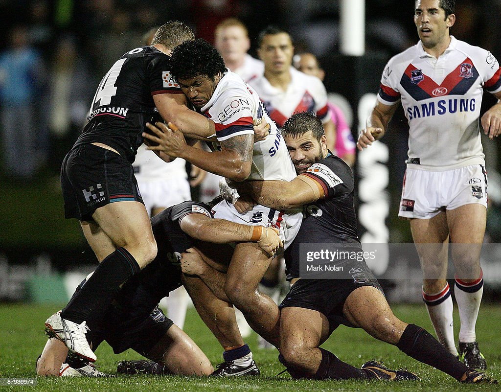 Frank-Paul Nuuausala of the Roosters is tackled during the round 11 NRL match between the Penrith Panthers and the Sydney Roosters at CUA Stadium on May 23, 2009 in Sydney, Australia.