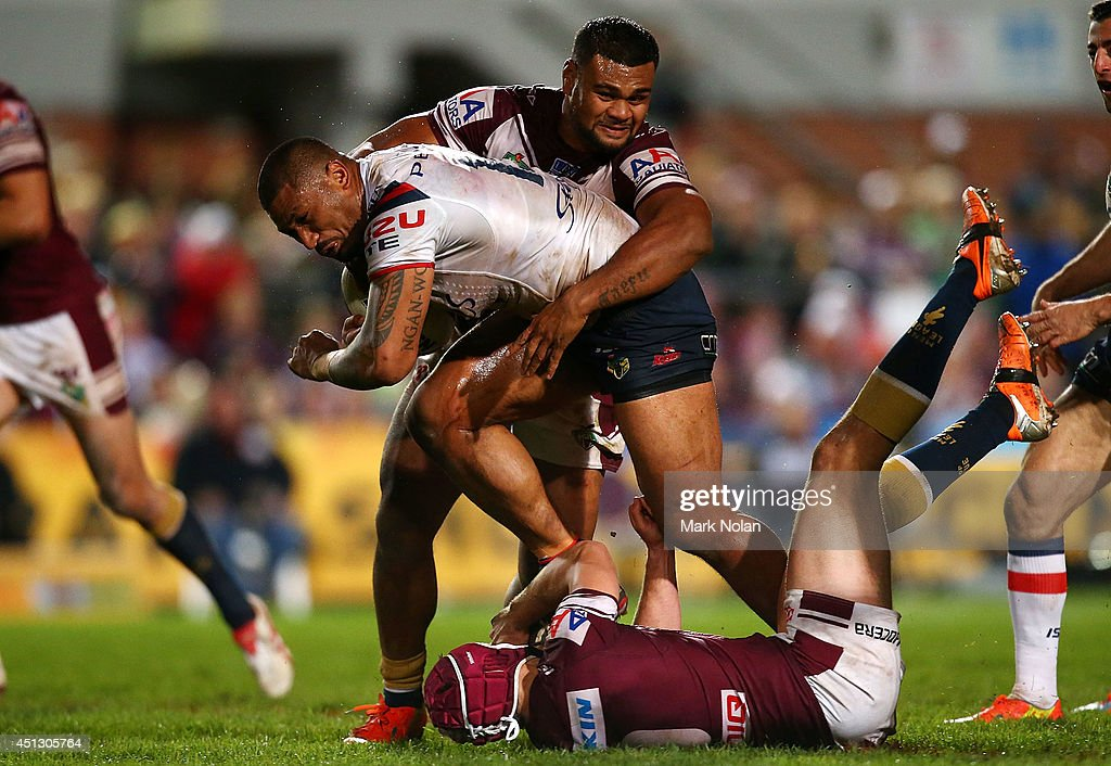 Frank-Paul Nuuausala of the Roosters takes on the defence during the round 16 NRL match between the Manly Sea Eagles and the Sydney Roosters at Brookvale Oval on June 27, 2014 in Sydney, Australia.