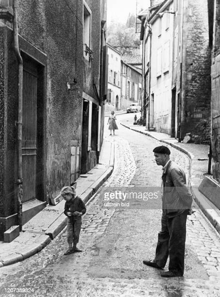 Man with child in an alley