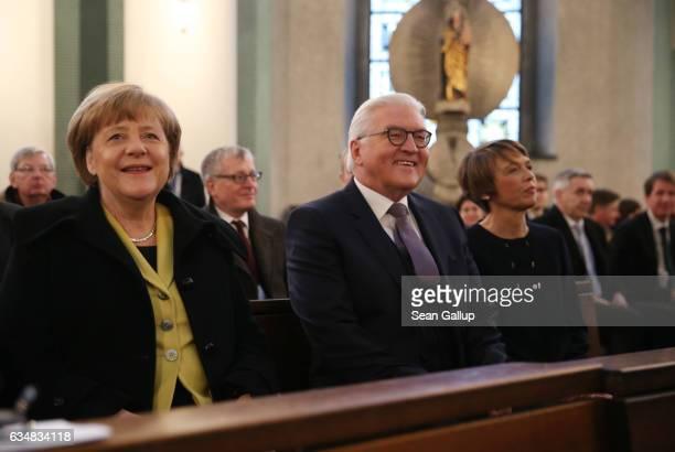 FrankWalter Steinmeier candidate for German president his wife Elke Buedenbender and German Chancellor Angela Merkel attend a church service at St...