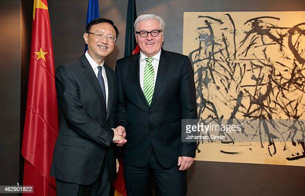 Frank-Walter Steinmeier , German minister of foreign affairs and Yang Jiechi, state councilor of the People's Republic of China shake hands ahead of...
