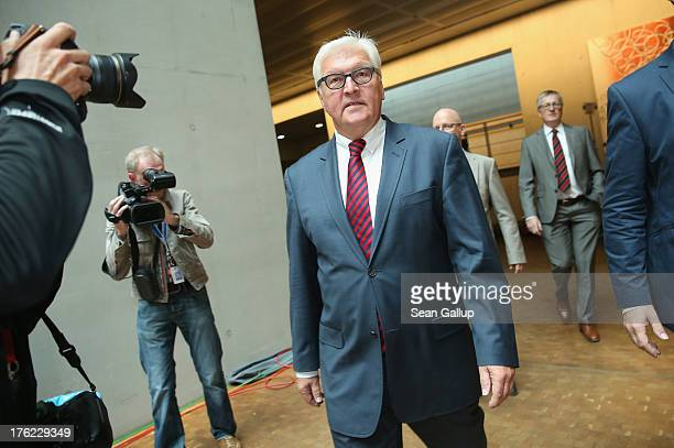 FrankWalter Steinmeier German Social Democrat arrives to speak to the media after the government cancelled an offer for Steinmeier to testify at a...