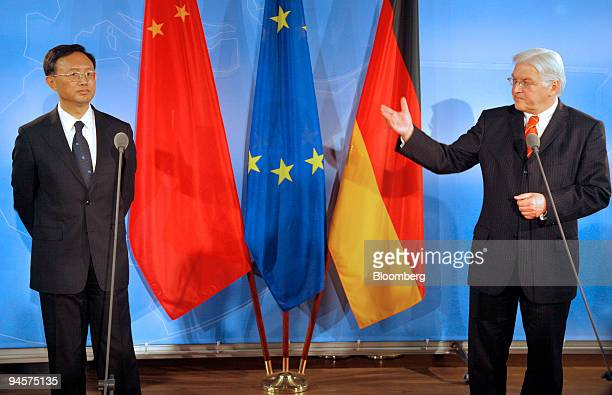 FrankWalter Steinmeier Germany's foreign minister right gestures to Yang Jiechi China's foreign minister in the Foreign Ministry in Berlin Germany on...