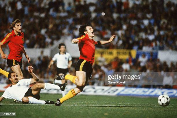 Franky Van der Elst of Belgium is brought down for a foul by Ulrich Stielike of Germany just outside the penalty area during the UEFA European...