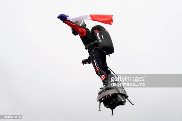 Franky Zapata on his jet-powered hoverboard or 'Flyboard' flies with the French national flag during a performance in tribute to late BWT Arden's...