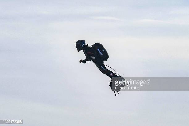 """Franky Zapata stands on his jet-powered """"flyboard"""" after he took off from Sangatte, northern France, on August 4 in an attempt to fly across the..."""