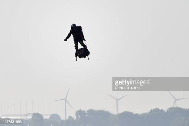 """Franky Zapata stands on his jet-powered """"flyboard"""" as he takes off from Sangatte, northern France, attempting to fly across the 35-kilometre Channel..."""