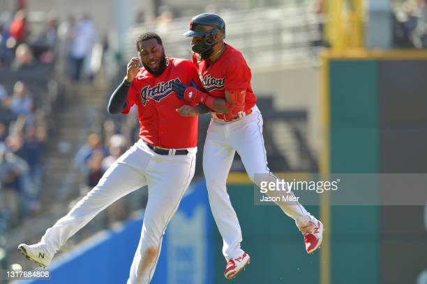 Franmil Reyes celebrates with Amed Rosario of the Cleveland Indians after Rosario hit a walk-off RBI single to defeat the Chicago Cubs at Progressive...