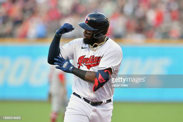 Franmil Reyes of the Cleveland Indians celebrates as he rounds the bases after hitting a three run homer off starting pitcher Jaime Barria of the Los...