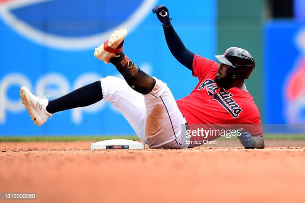 Franmil Reyes of the Cleveland Indians slides into second base for a double in the sixth inning during a game against the Detroit Tigers at...