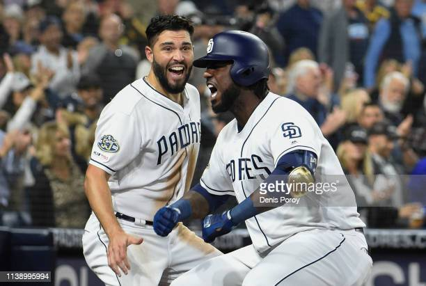 Franmil Reyes of the San Diego Padres celebrates with Eric Hosmer after hitting a solo home run during the sixth inning of a baseball game against...
