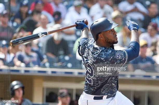 Franmil Reyes of the San Diego Padres hits an RBI double during the fifth inning of a baseball game against the Arizona Diamondbacks at PETCO Park on...