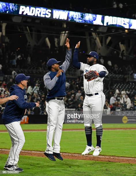 Franmil Reyes of the San Diego Padres right and Franchy Cordero celebrate after beating the Atlanta Braves 114 in a baseball game at PETCO Park on...