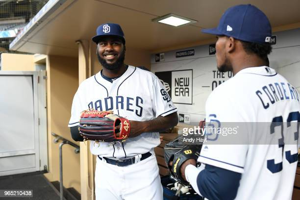 Franmil Reyes talks with Franchy Cordero of the San Diego Padres prior to the game against the Colorado Rockies at PETCO Park on May 14 2018 in San...