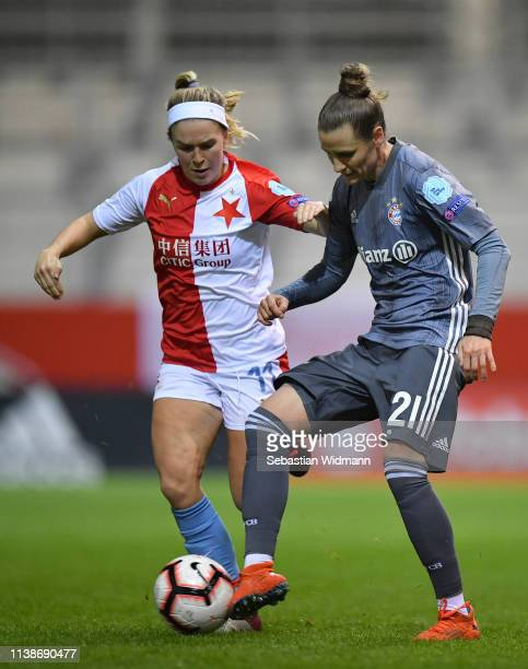 Franny Cerna of Slavia Prague and Simone Laudehr of Bayern Munich compete for the ball during the UEFA Women's Champions League Quarter Final Second...