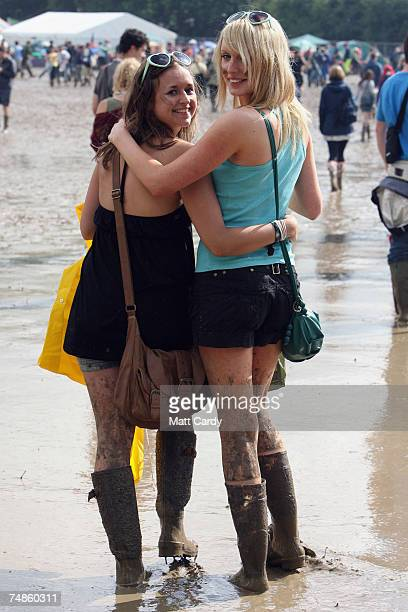 Franny Hernadez and Sophie Kidd walk in the mud at Worthy Farm Pilton near Glastonbury on June 22 2007 in Somerset England The festival that was...