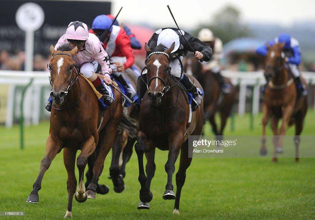 Franny Norton riding Mango Diva (pink) win The EBF Fund Upavon Fillies' Stakes at Salisbury racecourse on August 14, 2013 in Salisbury, England.
