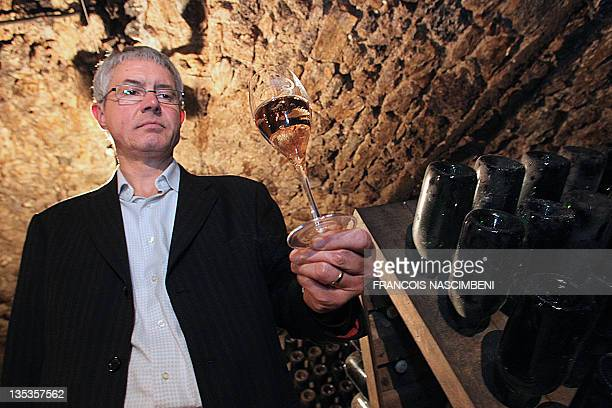 ' LE CHAMPAGNE ROSE PLUS FESTIF QUE LE BRUT ' François Domi cellar manager poses with a flute of rosé champagne on October 24 2011 in MareuilsurAy...