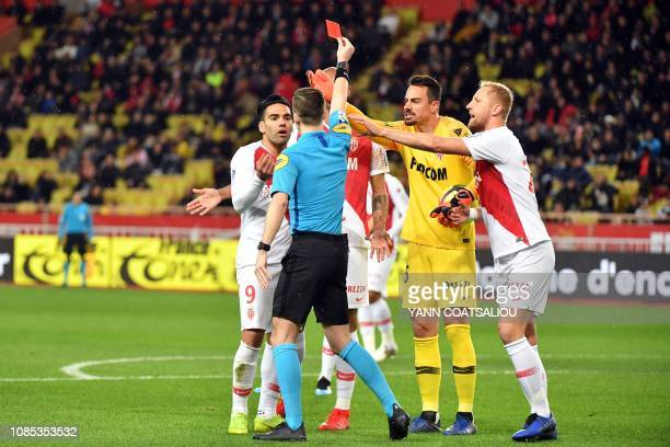 François Letexier shows a red to Monaco's Brazilian defender Naldo as Monaco's Colombian forward Radamel Falcao protest during the French L1 football...