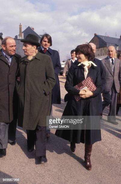 François Mitterrand accompagné de son épouse Danielle et de l'ancien pilote et industriel Guy Ligier à gauche circa 1980 en France
