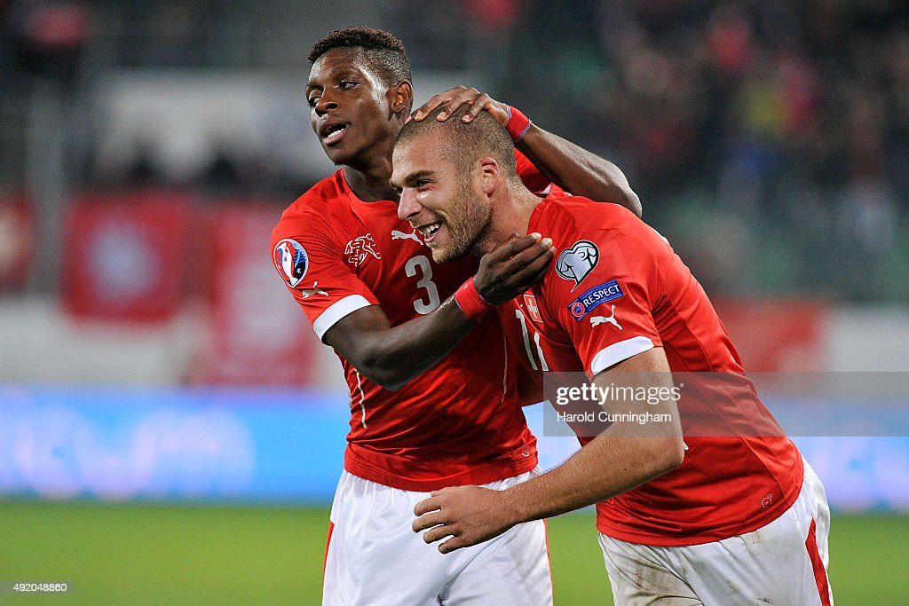 François Moubandje and Pajtim Kasami of Switzerland celebrate scoring the fifth goal during the UEFA EURO 2016 qualifier between Switzerland and San Marino at AFG Arena on October 9, 2015 in St Gallen, Switzerland.