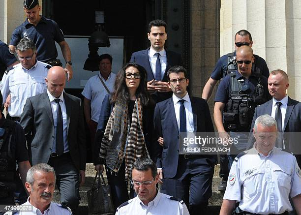 Françoise BettencourtMeyers daughter of France's richest woman Liliane Bettencourt flanked by her sons Nicolas and JeanVictor leaves on May 28 2015...
