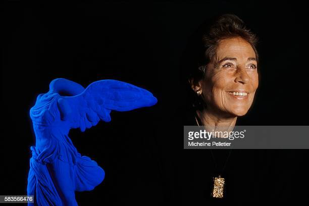 Françoise Giroud at home next to a statue of the Winged Victory of Samothrace redesigned by Yves Klein